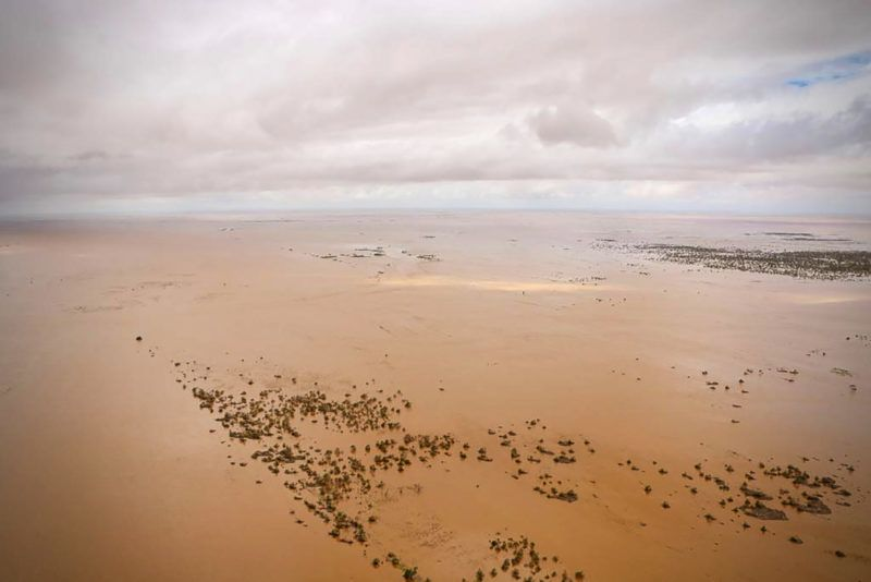 An aerial view shows the flooded plane surrounding Beira, central Mozambique, on March 20, 2019, after the passage of cyclone Idai. - International aid agencies raced on March 20 to rescue survivors and meet spiralling humanitarian needs in three impoverished countries battered by one of the worst storms to hit southern Africa in decades. Five days after tropical cyclone Idai cut a swathe through Mozambique, Zimbabwe and Malawi, the confirmed death toll stood at more than 300 and hundreds of thousands of lives were at risk, officials said. (Photo by ADRIEN BARBIER / AFP)