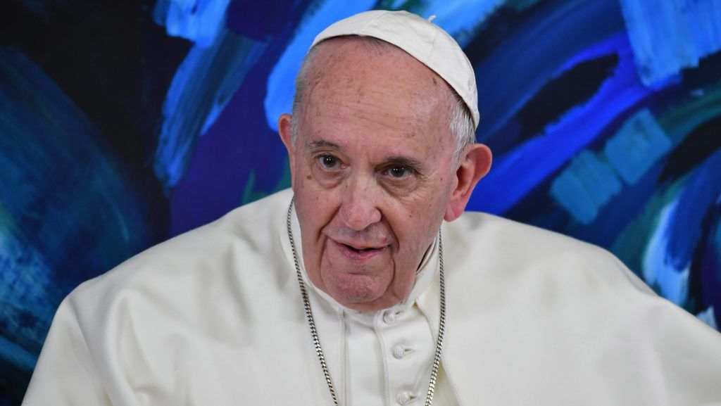 """Pope Francis takes part in a global live video conference at the headquarters of the Pontifical Foundation for Education """"Scholas Occurrentes"""" in Rome on March 21, 2019, during the launch of the international computer science peace project """"Planning for Peace"""". (Photo by Andreas SOLARO / POOL / AFP)"""