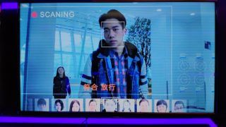 A visitor tries out the face recognition technology at the stand of Baidu during the ELEXCON 2018, also known as the EMBADDED Expo 2018, in Shenzhen city, south China's Guangdong province, 20 December 2018.