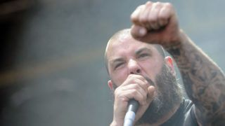 """The band 'Phil Anselmo & The Illegals' performs during a concert at the Nova Rock 2014 festival in Nickelsdorf, Austria, 15 June 2014. The event runs from 13 to 15 June. (Photo credit should read """"HERBERT P. OCZERET/APA-PictureDesk via AFP"""")"""