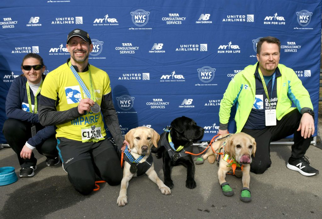 NEW YORK, NEW YORK - MARCH 17: EDITORIAL USE ONLY Guiding Eyes for the Blind President and CEO, Thomas Panek, runs the first ever 2019 United Airlines NYC Half Led Completely by Guide Dogs, Waffle, Westley and Gus on March 17, 2019 in New York City.   Craig Barritt/Getty Images for Guiding Eyes For The Blind/AFP