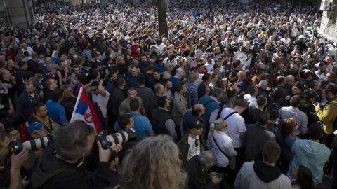 Protesters gather during a demonstration against Serbian President Aleksandar Vucic outside the presidential building in Belgrade, on March 17, 2019. - Opposition supporters gathered outside the presidential building during a press conference of Serbian President Aleksandar Vucic, a day after opponents broke into the state-run RTS television building, demanding to address the population, in images aired live. There have been weekly opposition protests since December against what they describe as Vucic's slide towards autocratic rule, while accusing RTS of pandering to the ruling party and demanding more airtime for opposing views. (Photo by Vladimir Zivojinovic / AFP)