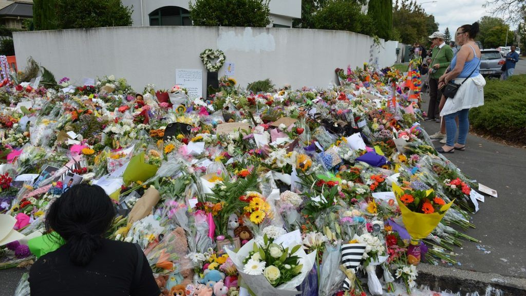 CHRISTCHURCH, NEW ZEALAND - MARCH 19: People place flowers at memorial sites as a tribute to victims of the Friday's terrorist attacks on two mosques that left at least 50 people killed in Christchurch, in New Zealand on March 19, 2019.  At least 50 people were reportedly killed in twin terror attacks targeting mosques in Christchurch, New Zealand, an official said on Friday. Witnesses claim the Al Noor Mosque was targeted by armed assailants and there were up to 200 people inside for Friday Prayers.    Recep Sakar / Anadolu Agency