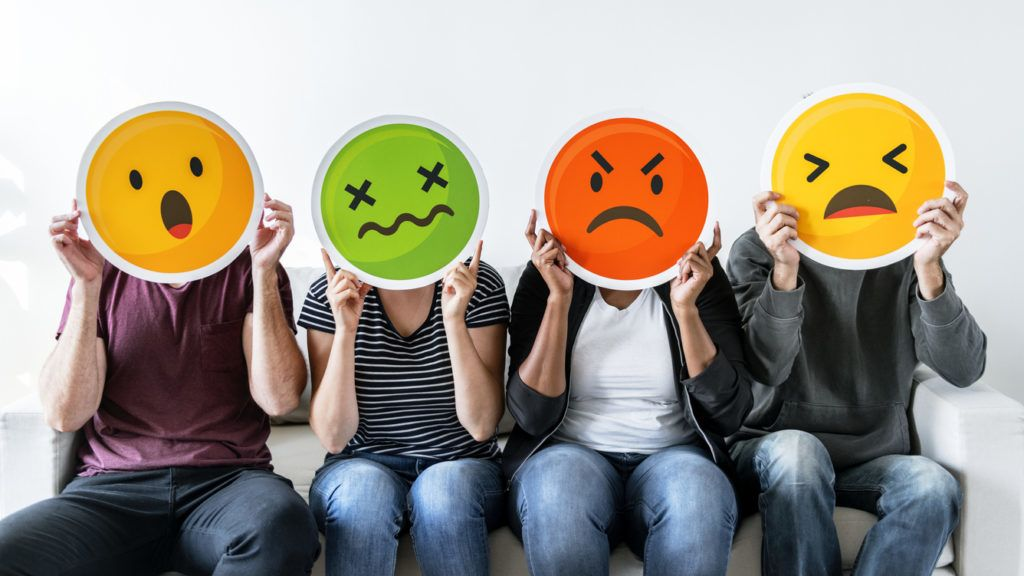 Diverse people holding emoticon ***These graphics are derived from our own 3D generic designs. They do not infringe on any copyright design. a