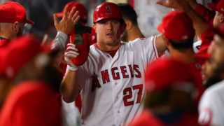 ANAHEIM, CA - SEPTEMBER 25:  Mike Trout #27 of the Los Angeles Angels of Anaheim celebrates during the game against the Texas Rangers at Angel Stadium on September 25, 2018 in Anaheim, California.  (Photo by Masterpress/Getty Images)