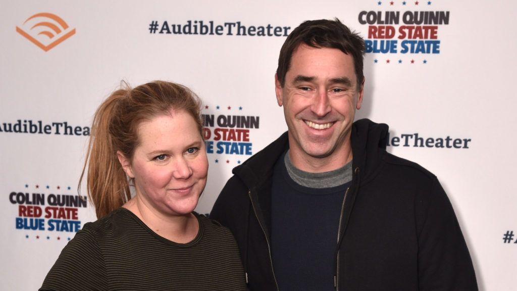 """NEW YORK, NY - JANUARY 22: Amy Schumer and Chris Fischer attend the Opening Night for Colin Quinn's """"Red State Blue State"""" at Audible's Minetta Lane Theatre in NYC at the Minetta Lane Theatre on January 22, 2019 in New York City.  (Photo by Bryan Bedder/Getty Images for Audible)"""
