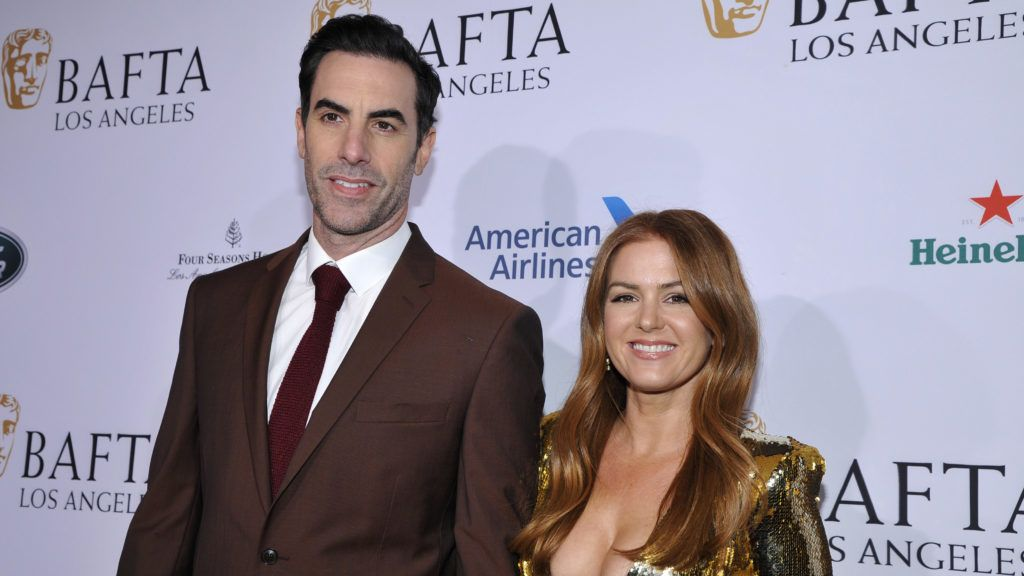 BEVERLY HILLS, CALIFORNIA - JANUARY 05: (L-R) Sacha Baron Cohen and Isla Fisher arrive to the BAFTA Tea Party at The Four Seasons Hotel Los Angeles at Beverly Hills on January 05, 2019 in Beverly Hills, California. (Photo by John Sciulli/Getty Images for BAFTA Los Angeles )
