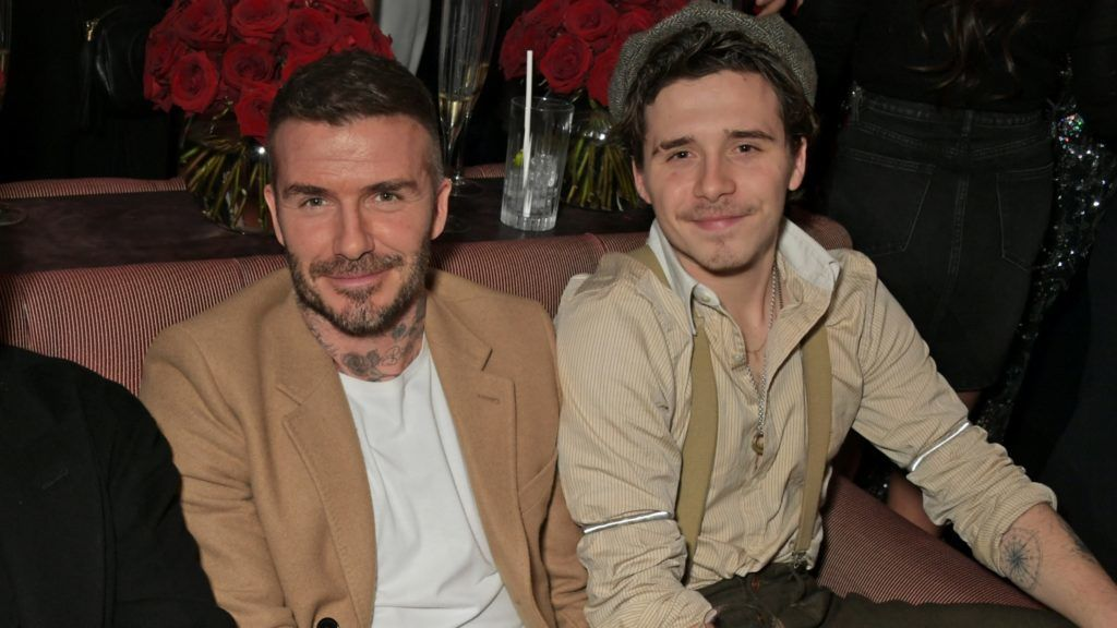 LONDON, ENGLAND - FEBRUARY 17: (L to R)  Kim Jones, David Beckham and Brooklyn Beckham attend the Victoria Beckham x YouTube Fashion & Beauty after party at London Fashion Week hosted by Derek Blasberg & David Beckham at Mark's Club on February 17, 2019 in London, England.  (Photo by David M. Benett/Dave Benett/Getty Images for YouTube)