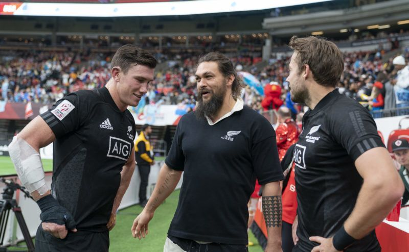 VANCOUVER, BC - MARCH 10: Jason Momoa speaks with Sam Dickson #2 and Tim Mikkelson of New Zealand after their final match on Day 2 of the HSBC Canada Sevens at BC Place on March 10, 2019 in Vancouver, Canada. (Photo by Rich Lam/Getty Images)