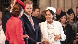 LONDON, ENGLAND - MARCH 11: Catherine, The Duchess of Cambridge talks with the Meghan, Duchess of Sussex at Westminster Abbey Commonwealth day service on March 11, 2019 in London, England. Commonwealth Day has a special significance this year, as 2019 marks the 70th anniversary of the modern Commonwealth, with old ties and new links enabling cooperation towards social, political and economic development which is both inclusive and sustainable. The Commonwealth represents a global network of 53 countries and almost 2.4 billion people, a third of the worlds population, of whom 60 percent are under 30 years old. Each year the Commonwealth adopts a theme upon which the Service is based. This years theme A Connected Commonwealth speaks of the practical value and global engagement made possible as a result of cooperation between the culturally diverse and widely dispersed family of nations, who work together in friendship and goodwill. The Commonwealths governments, institutions and people connect at many levels, including through parliaments and universities. They work together to protect the natural environment and the ocean which connects many Commonwealth nations, shore to shore. Cooperation on trade encourages inclusive economic empowerment for all people - particularly women, youth and marginalised communities. The Commonwealths friendly sporting rivalry encourages people to participate in sport for development and peace. (Photo by Richard Pohle - WPA Pool/Getty Images)