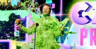 LOS ANGELES, CA - MARCH 23:  Favorite butt-kicker winner for 'Jurassic World: Fallen Kingdom' actor Chris Pratt gets slimed on stage during the 32nd Annual Nickelodeon's 2019 Kids' Choice Awards at Galen Center on March 23, 2019 in Los Angeles, California.  (Photo by Kevin Mazur/KCA2019/Getty Images for Nickelodeon)