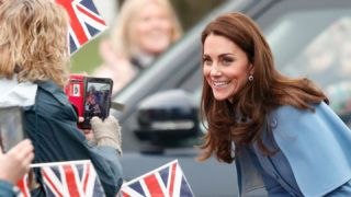 BALLYMENA, NORTHERN IRELAND - FEBRUARY 28: (EMBARGOED FOR PUBLICATION IN UK NEWSPAPERS UNTIL 24 HOURS AFTER CREATE DATE AND TIME) Catherine, Duchess of Cambridge meets members of the public as she visits CineMagic at the Braid Arts Centre on February 28, 2019 in Ballymena, Northern Ireland. Prince William last visited Belfast in October 2017 without his wife, Catherine, Duchess of Cambridge, who was then pregnant with the couple's third child.  This time the couple concentrate on the young people of Northern Ireland. Their engagements include a visit to Windsor Park Stadium, home of the Irish Football Association, activities at the Roscor Youth Village in Fermanagh, a party at the Belfast Empire Hall, Cinemagic - a charity that uses film, television and digital technologies to inspire young people and finally dropping in on a SureStart early years programme. (Photo by Max Mumby/Indigo/Getty Images)