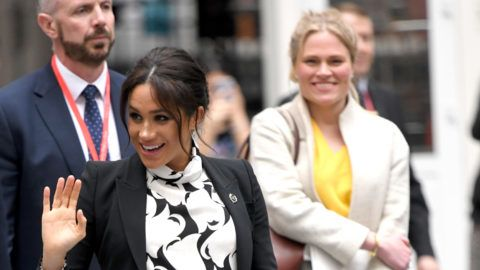 LONDON, ENGLAND - MARCH 08: Meghan, Duchess of Sussex and Amy Pickerill (R) depart after joining a panel discussion convened by The Queen's Commonwealth Trust to mark International Women's Day at King's College London on March 08, 2019 in London, England. (Photo by Karwai Tang/WireImage)