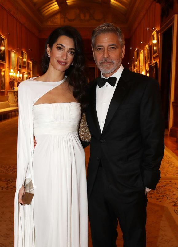 LONDON, ENGLAND - MARCH 12: Amal Clooney and George Clooney attend a dinner to celebrate The Prince's Trust, hosted by Prince Charles, Prince of Wales at Buckingham Palace on March 12, 2019 in London, England. The Prince of Wales, President, The Prince's Trust Group hosted a  dinner for donors, supporters and ambassadors of Prince's Trust International. (Photo by Chris Jackson - WPA Pool/Getty Images)
