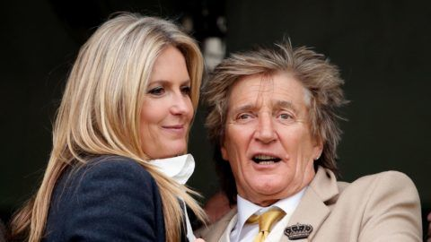 CHELTENHAM, UNITED KINGDOM - MARCH 14: (EMBARGOED FOR PUBLICATION IN UK NEWSPAPERS UNTIL 24 HOURS AFTER CREATE DATE AND TIME) Penny Lancaster and Sir Rod Stewart watch the racing as they attend day 3 'St Patrick's Thursday' of the Cheltenham Festival at Cheltenham Racecourse on March 14, 2019 in Cheltenham, England. (Photo by Max Mumby/Indigo/Getty Images)