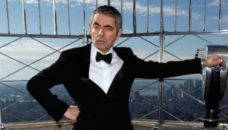 """NEW YORK, NY - OCTOBER 17:  Rowan Atkinson as """"Johnny English"""" visits The Empire State Building on October 17, 2011 in New York City.  (Photo by Robin Marchant/FilmMagic)"""