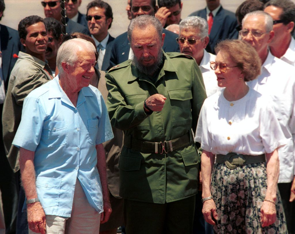 405512 03: Cuban leader Fidel Castro (C) speaks with the former U.S. President Jimmy Carter (L) and his wife Rosalyn during a departure ceremony at Jose Marti International airport May 17, 2002 in Havana, Cuba. Carter visited for six days in an effort to improve relations between the U.S. and Cuba. (Photo by Jorge Rey/Getty Images)