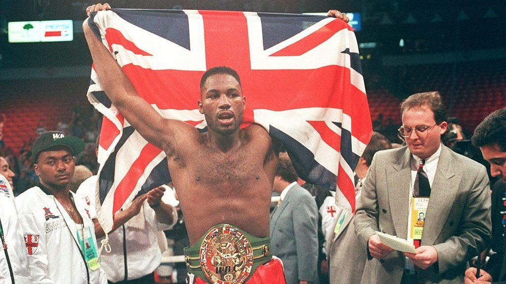 8 May 1993:  Lennox Lewis of Great Britain holds aloft the union jack after beating Tony Tucker of the USA in Las Vegas, Nevada in the USA
