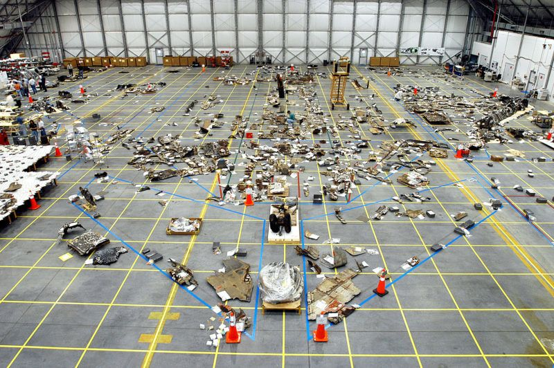KENNEDY SPACE CENTER, FL - MAY 15:  (FILE PHOTO)  In this NASA handout, Columbia Space Shuttle debris lies floor of the RLV Hangar May 15, 2003 at Kennedy Space Center, Florida. The Columbia Accident Investigation Board investigators say that a culture of low funding, strict scheduling and an eroded safety program at NASA doomed the flight of the space shuttle.  (Photo by NASA/Getty Images)