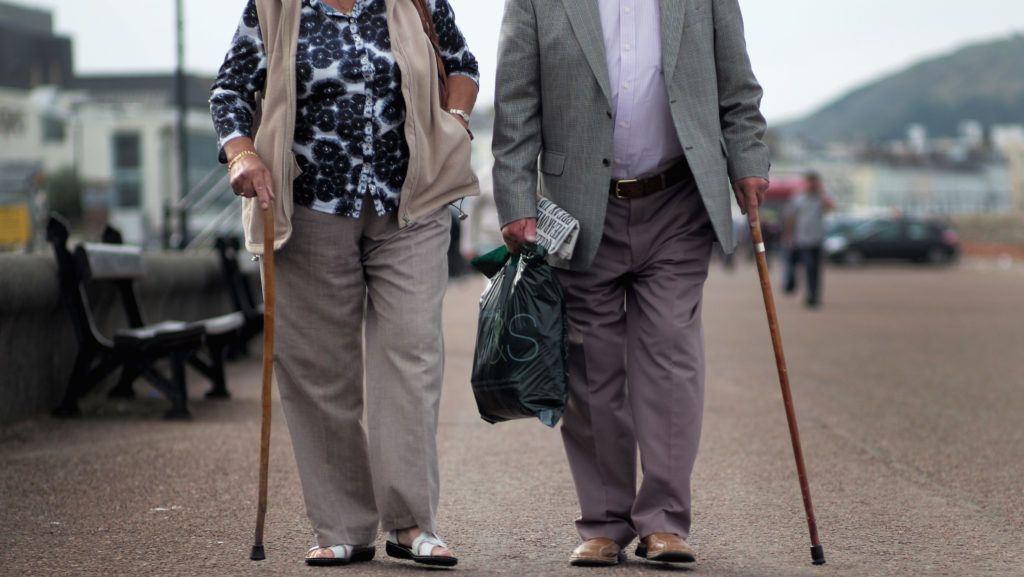 LLANDUDNO, WALES - SEPTEMBER 08:  Senior citizens walk along Llandudno Promenade on September 8, 2014 in Llandudno, Wales. Britain is facing multiple problems stemming from an increase in the elderly proportion of its population, including increasing health care costs, strains on its social security system, a shortage of senior care workers and challenges to the employment market.  (Photo by Christopher Furlong/Getty Images)