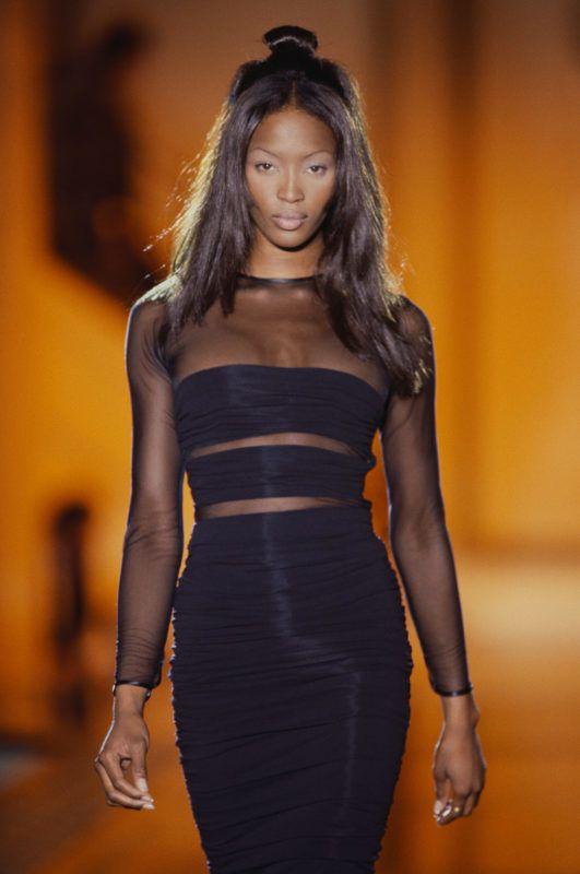 Supermodel Naomi Campbell Wearing Versace Black Dress (Photo by  Michel Arnaud/CORBIS/Corbis via Getty Images)