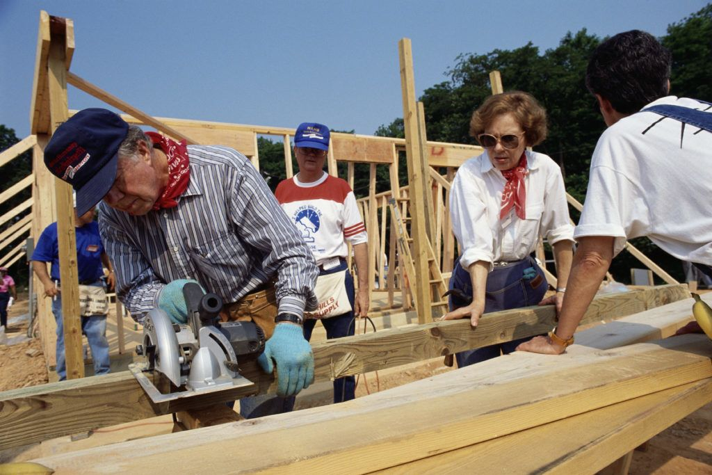 Jimmy Carter and wife Rosalynn Carter sawing lumber for a house for Habitat for Humanity. The Carters lead the Jimmy Carter Work Project (JCWP) for Habitat for Humanity International one week each year. (Photo by mark peterson/Corbis via Getty Images)