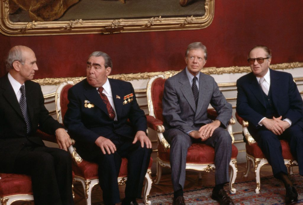 Soviet leader Leonid Brezhnev and US President Jimmy Carter sit together at the beginning of the SALT II treaty conference in Vienna, Austria in June 1979. The historic treaty they signed was intended to assure a balance of nuclear resources between the two superpowers. (Photo by © Wally McNamee/CORBIS/Corbis via Getty Images)