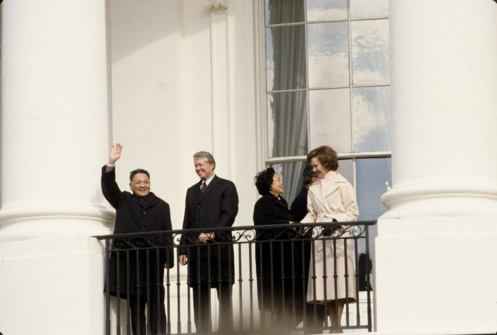 Jimmy Carter with Chinese leader Deng Xiao Ping at the White House on balcony overlooking the South Lawn, with Deng's wife, Cho Lin, and Rosalynn Carter, Washington, DC, January 1979. (Photo by Chuck Fishman/Getty Images)