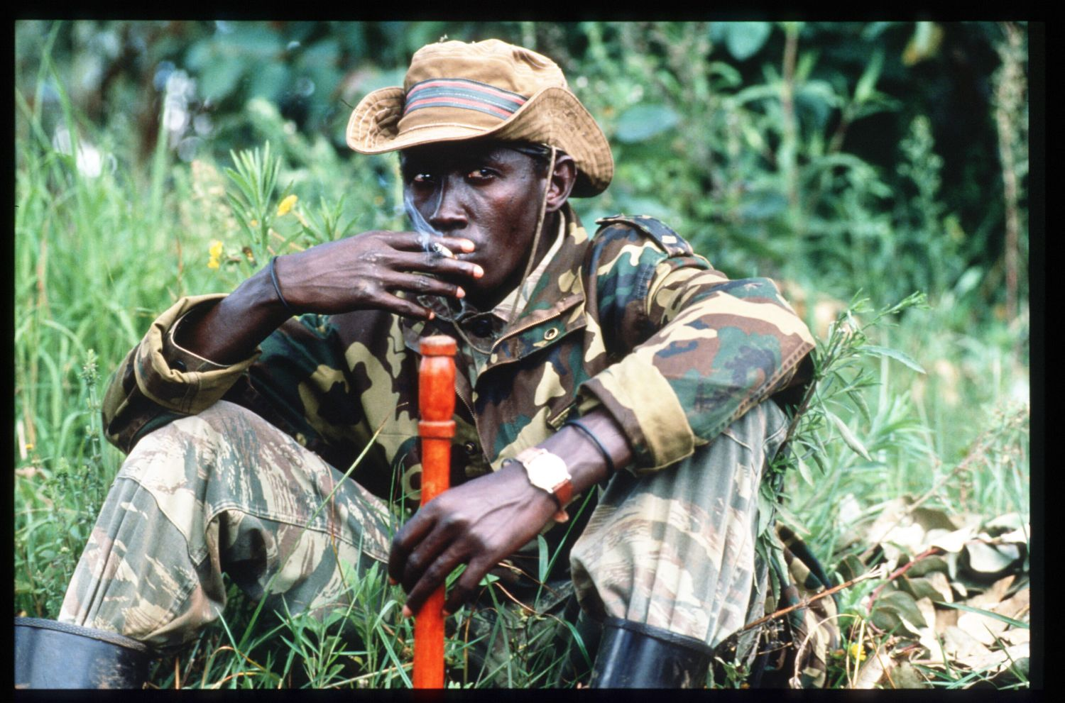 185252 35: A Rwandan Patriotic Front soldier smokes a cigarette April 7, 1994 outside of Byumba, Rwanda. Following the apparent assassination of Rwandan President Juvenal Habyarimana, the Hutu government and its supporters killed thousands of Tutsi civilians, renewing the civil war between the Tutsi-led RPF and the Hutu-backed government. (Photo by Scott Peterson/Liaison)
