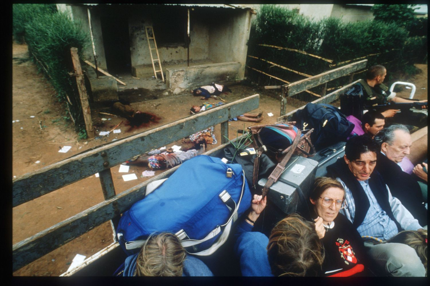 185349 20: A truckload of evacuating Belgian civilians drives past corpses April 11, 1994 in Kigali, Rwanda. The majority of French and Belgian nationals living in Rwanda have decided to leave, after civil war between Hutus and Tutsis has left between 500,000 and one million dead. (Photo by Scott Peterson/Liaison)