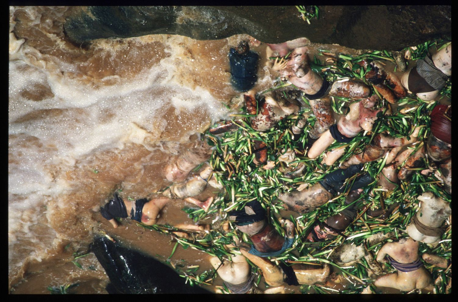 187079 38: Corpses float down the Akagara River May 3, 1994 at the border of Rwanda and Tanzania. Hutu refugees have fled to Tanzania across the Akagara River in order to escape reprisals by Tutsi rebels. (Photo by Scott Peterson/Liaison)