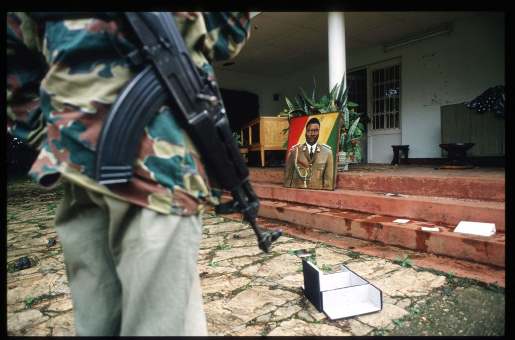 189913 04: An armed Rwandan Patriotic Front soldier stands in front of the home of Major General JuvTnal Habyarimana May 26, 1994 in Kigali, Rwanda. Habyarimana died May 6th in a plane crash that precipitated the ongoing civil war. (Photo by Scott Peterson/Liaison)