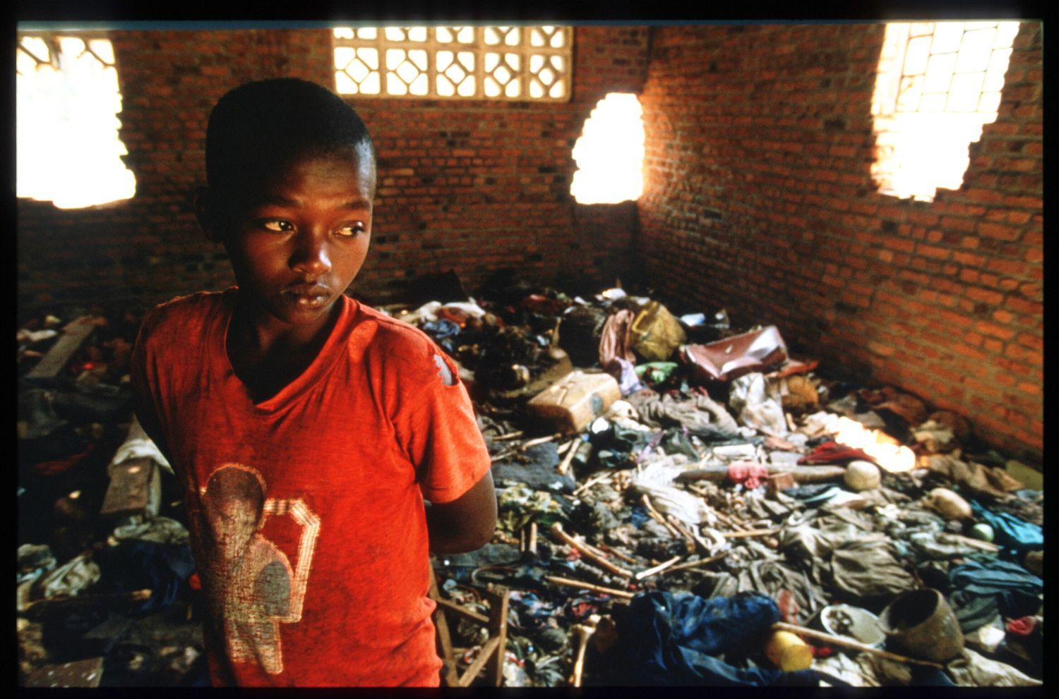 197284 05: A local child stands amid the debris September 16, 1994 at a church in Ntarama, Rwanda. The bodies of four hundred Tutsis murdered by Hutu militiamen were found in the church at Ntarama by an Australian-led United Nations team. (Photo by Scott Peterson/Liaison)
