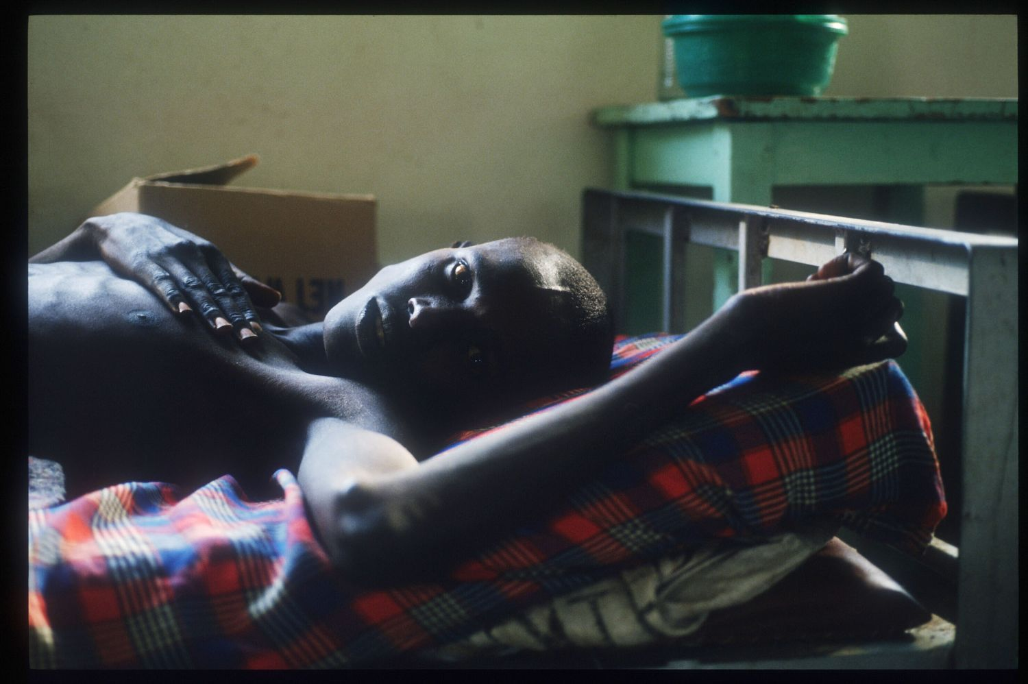 218317 91: A liberated refugee lies in Kabgayi Hospital May 25, 1994 in Rwanda. Following the assassination of President Juvenal Habyarimana in April, 1994 genocide of unprecedented swiftness left up to one million Tutsis and moderate Hutus dead at the hands of organized bands of militia by early July, 1994. (Photo by Scott Peterson/Liaison)