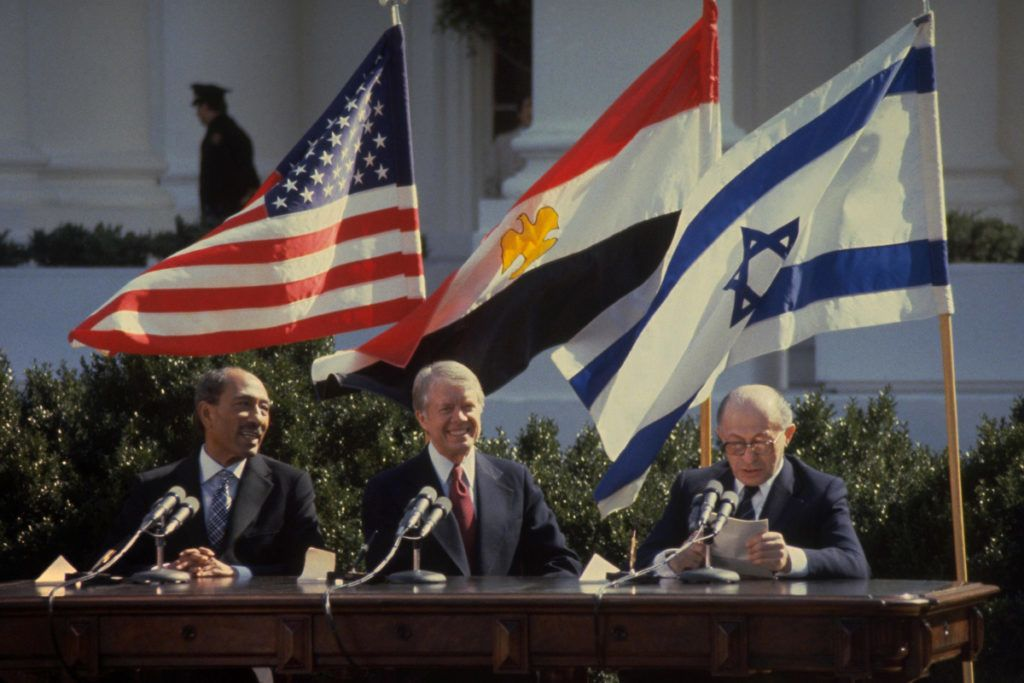 WASHINGTON DC - MARCH 26: This handout file photo provided by the Israeli Government Press Office (GPO) on March 25, 2009, shows Israeli Prime Minister Menahem Begin (R) addressing the peace treaty signing ceremony as Egyptian President Anwar Sadat (L) and U.S. President Jimmy Carter watch on the White House lawn on March 26, 1979 in Washington, DC. Israel and Egypt will mark 30 years since their then leaders signed the historic agreement, making Egypt the first Arab nation to recognize the Jewish State.  (Photo by Ya'akov Sa'ar/GPO via Getty Images)