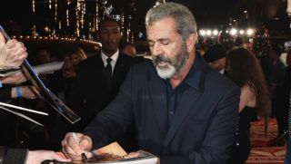 LONDON, ENGLAND - NOVEMBER 16:  Mel Gibson signs autographs at the UK Premiere of 'Daddy's Home 2' at Vue West End on November 16, 2017 in London, England.  (Photo by Gareth Cattermole/Getty Images for Paramount Pictures)