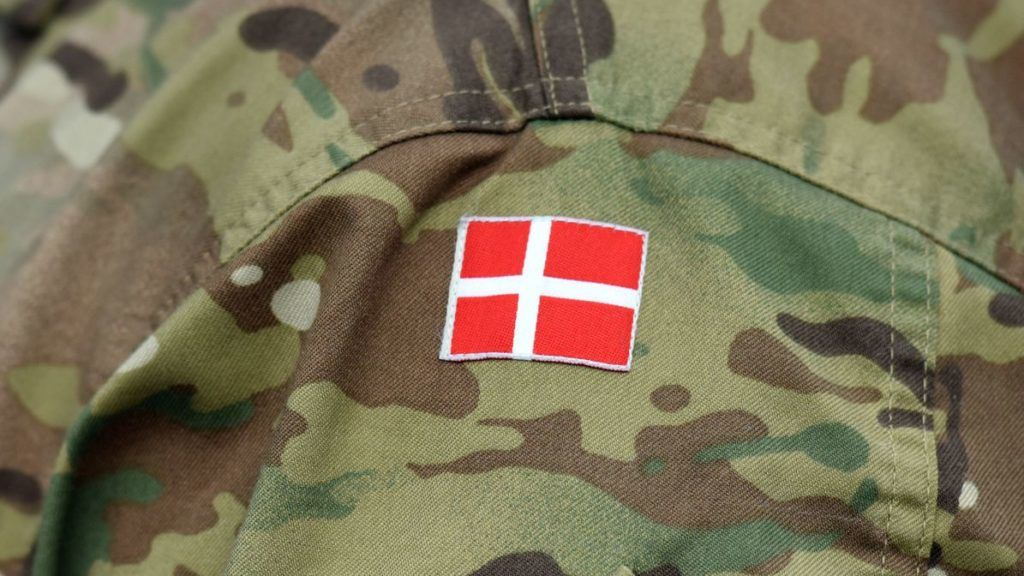Denmark patch flag on soldiers arm. Denmark military uniform. Danish troops