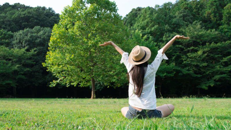 Woman relaxing in a lawn