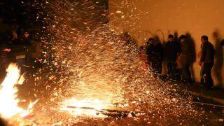 BAKU, AZERBAIJAN - MARCH 12: People gather around the bonfire as part of the Newroz celebrations, marking the arrival of spring in Baku, Azerbaijan on March 12, 2019.   Resul Rehimov / Anadolu Agency