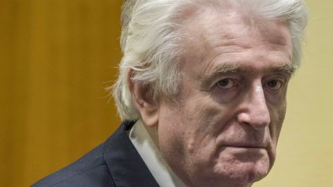 Former Bosnian Serb leader Radovan Karadzic reacts at the court room of the International Residual Mechanism for Criminal Tribunals in The Hague, Netherlands, on March 20, 2019, while waiting to hear the final judgement on his role in the bloody conflict that tore his country apart a quarter of a century ago. - Karadzic is sentence to life imprisonment by UN judges on March 20, 2019. Radovan Karadzic  was notorious for his role in the 1995 Srebrenica massacre where more than 8,000 Muslim men and boys were slaughtered in the worst bloodletting on European soil since World War II. (Photo by Peter Dejong / POOL / AFP)
