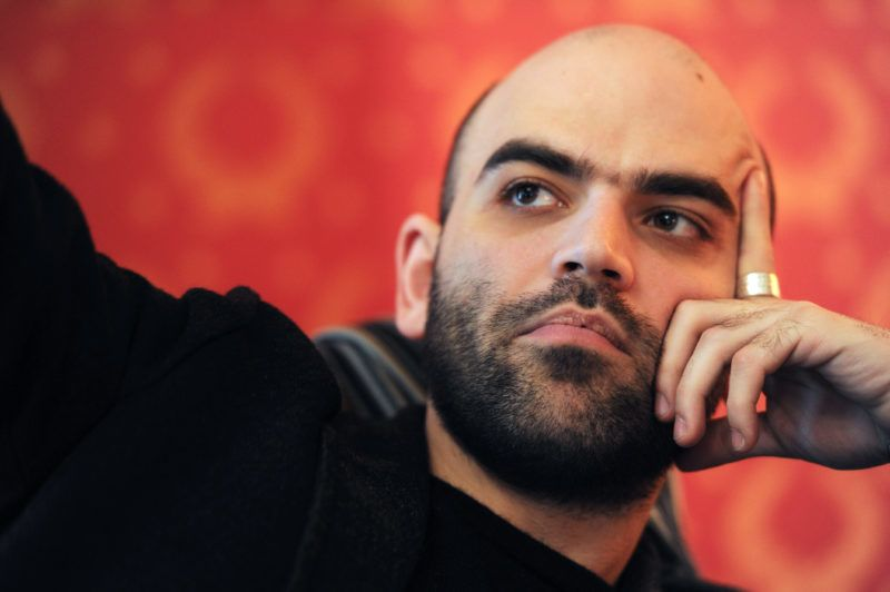 """Italian writer Roberto Saviano gives an interview on March 17, 2010 in Rome. Saviano, 29, whose book """"Gomorrah"""" has been translated into 42 languages, has lived under police protection for two years. The screen version of """"Gomorrah,"""" directed by Matteo Garrone, won second prize at the 2008 Cannes film festival and was in the running for an Oscar. His book, exposes the workings of the powerful Naples mafia, the Camorra.      AFP PHOTO / CHRISTOPHE SIMON (Photo by CHRISTOPHE SIMON / AFP)"""