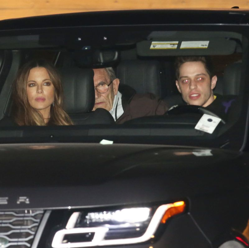 Tuesday, March 19, 2019 - After a series of very public make out sessions, 45-year-old Kate Beckinsale and her young beau Pete Davidson, 25, enjoy an oceanfront dinner outing at Nobu in Malibu. The couple are accompanied by Kate's mother, English actress Judy Loe, and her step-father, British television director, Roy Battersby. ROL-Daddy-Juliano/X17online.com March 19, 2019