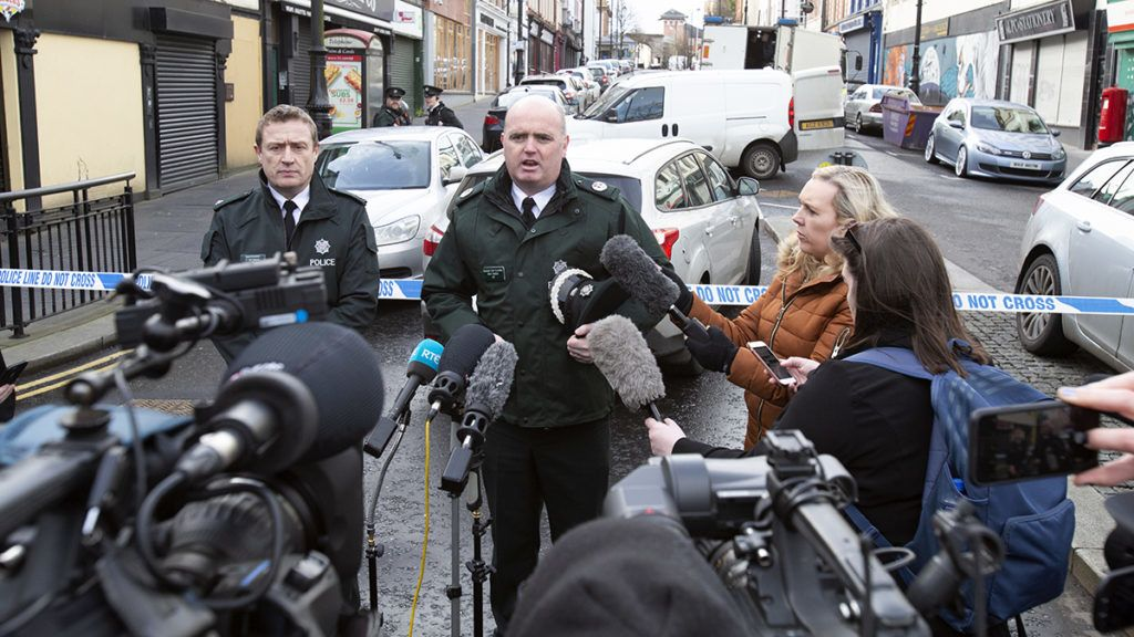 Assitant Chief Constable Mark Hamilton (C) speaks at the scene of a suspected car bomb explosion in Derry, Northern Ireland, on January 20, 2019. - A suspected car bomb exploded in the Northern Irish city of Derry (Londonderry) on January 19, police said, with leading politicians alleging the blast was terror-related. (Photo by Paul FAITH / AFP)