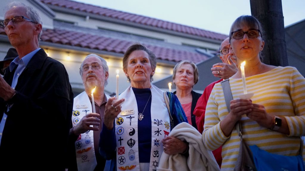 Mourners participate in a candle light vigil for the victims of the Chabad of Poway Synagogue shooting at the Rancho Bernardo Community Presbyterian Church on April 27, 2019 in Poway, California. - A teenage gunman who wrote a hate-filled manifesto opened fire at a synagogue in California on April 27, killing one person and injuring three others including the rabbi as worshippers marked the final day of Passover, authorities said. (Photo by SANDY HUFFAKER / AFP)