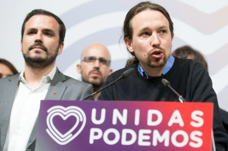 """Spanish far-left Podemos party leader Pablo Iglesias (R) delivers a speech with the leader of Izquierda Unida party, Alberto Garzon (L) during an election night rally of far-left """"Unidas Podemos"""" coalition in Madrid after Spain held general elections on April 28, 2019. - Spain's socialist prime minister won snap elections today but without the necessary majority to govern in a fragmented political landscape marked by the far-right's dramatic eruption in parliament. (Photo by CURTO DE LA TORRE / AFP)"""