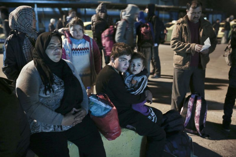 Immigrants wait in the port of Lesvos island to board a ship to Athens on April 17, 2015. Since Greece bolstered controls along its land border with Turkey, along the Evros River, illegal immigrants have turned to the maritime route between Turkey and the Greek islands in the Aegean Sea, notably Lesvos, Samos, Kos and Chios. 2015 started with a major increase in the number of Aegean crossings : 10,445 against 2,863 in the same period of 2014, according to the Greek port police. AFP PHOTO / ANGELOS TZORTZINIS (Photo by ANGELOS TZORTZINIS / AFP)