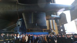 5857288 23.04.2019 Russian sailors and workers of JSC Sevmash attend the ceremony of the Belgorod nuclear submarine launch, in Severodvynsk, Russia. Igor Ageyenko / Sputnik