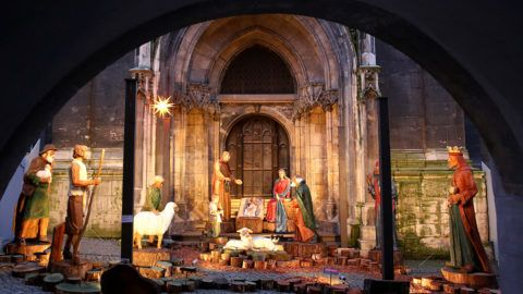 A life-size Nativity scene featuring carved wooden figures outside the Alderman's Gate by the Wenzel Church in Naumburg, Germany, 28 November 2016. The sculptor Stefan Albert Hutter chiselled the figures of the Holy Family using oak after being commissioned by the city in 2012. The figures of the Magi, shepherd and various animals were added later. Photo: Jan Woitas/dpa-Zentralbild/dpa