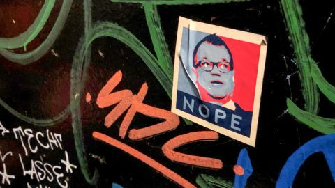 """20 March 2019, Finland, Tampere: A sticker with the portrait of the former Finnish head of government Juha Sipilä sticks to the wall of a pub in Tampere.       (to choose dpa """"The happy Finns - reforms and Russia in view"""") Photo: Steffen Trumpf/dpa"""