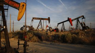 MCKITTRICK, CA - MARCH 23: Pump jacks and wells are seen in an oil field on the Monterey Shale formation where gas and oil extraction using hydraulic fracturing, or fracking, is on the verge of a boom on March 23, 2014 near McKittrick, California. Critics of fracking in California cite concerns over water usage and possible chemical pollution of ground water sources as California farmers are forced to leave unprecedented expanses of fields fallow in one of the worst droughts in California history. Concerns also include the possibility of earthquakes triggered by the fracking process which injects water, sand and various chemicals under high pressure into the ground to break the rock to release oil and gas for extraction though a well. The 800-mile-long San Andreas Fault runs north and south on the western side of the Monterey Formation in the Central Valley and is thought to be the most dangerous fault in the nation. Proponents of the fracking boom saying that the expansion of petroleum extraction is good for the economy and security by developing more domestic energy sources and increasing gas and oil exports.   David McNew/Getty Images/AFP